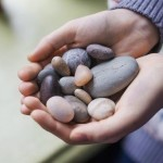 hands with stones